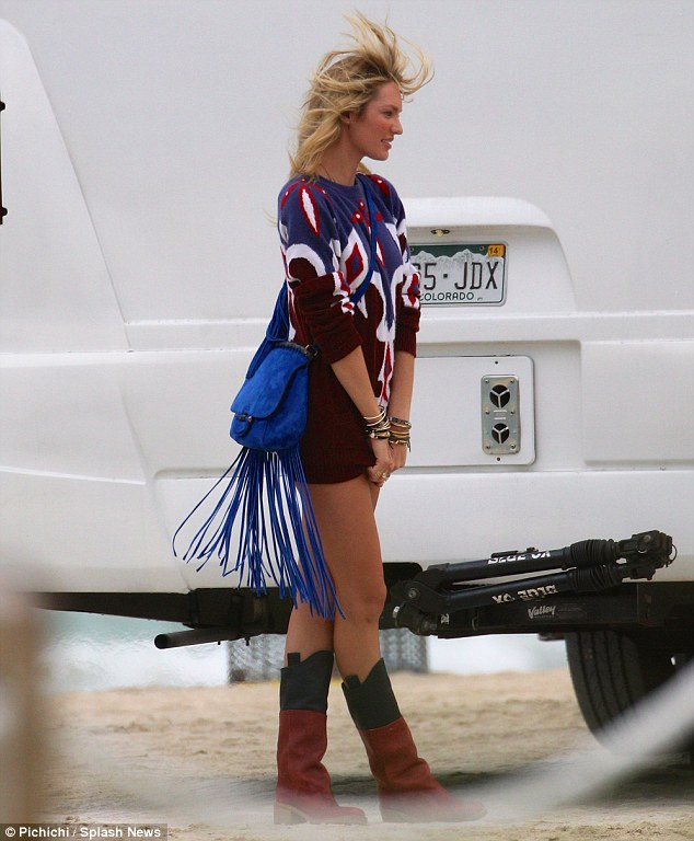 Shoot to thrill: Candice showed off a number of fun outfits on the day in Miami