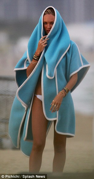 Interesting beach wear: Not all of the poses were instantly recognisable as being stylish