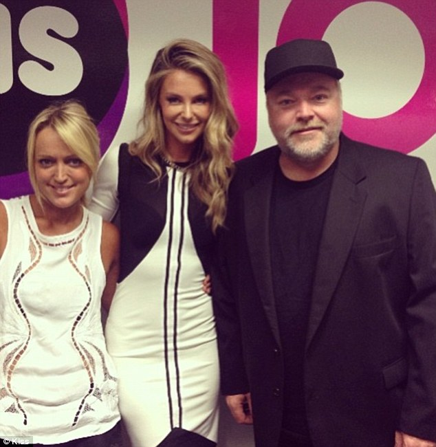 Happy snap: The blonde stunner posed in between the radio hosts