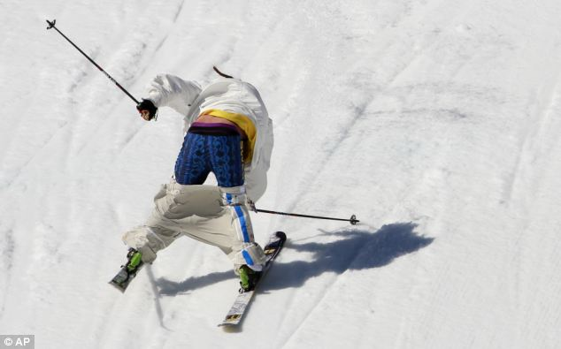 Hard landing: Henrik Harlaut moments before crashing during the men's ski slopestyle qualifying at the Rosa Khutor Extreme Park. Both he and his trousers lost a losing battle with gravity