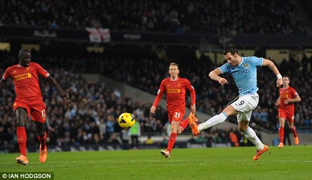 Alvaro Negredo scores during City's defeat of Liverpool
