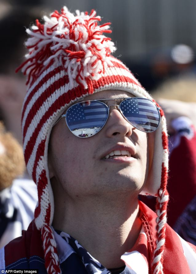 Blaring sun: A U.S. fan watches the Men's Freestyle Skiing Slopestyle finals at the Rosa Khutor Extreme Park