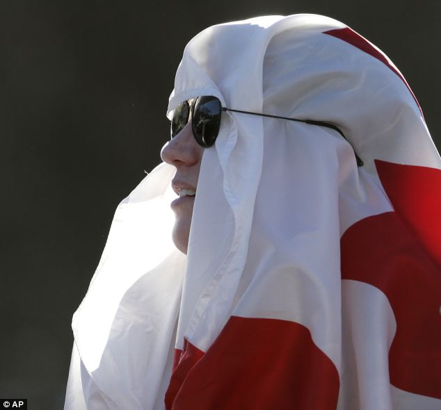 Unforgiving: The sun was beating down on this spectator who watched the women's skeleton competition
