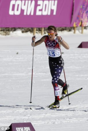 Sadie Bjornsen of the U.S. (left) skis in the finish area after completing the 10k classical-style cross-country race while Sophie Caldwell, also Team USA, (right) skis with a sleeveless top in the same race