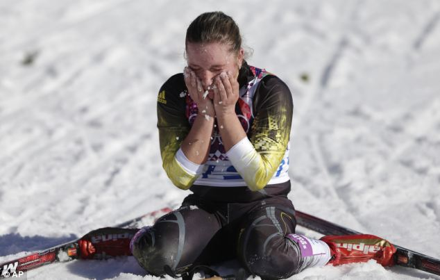Moldova's Alexandra Camenscic cools herself with snow after finishing the women's 10K classical-style cross-country race