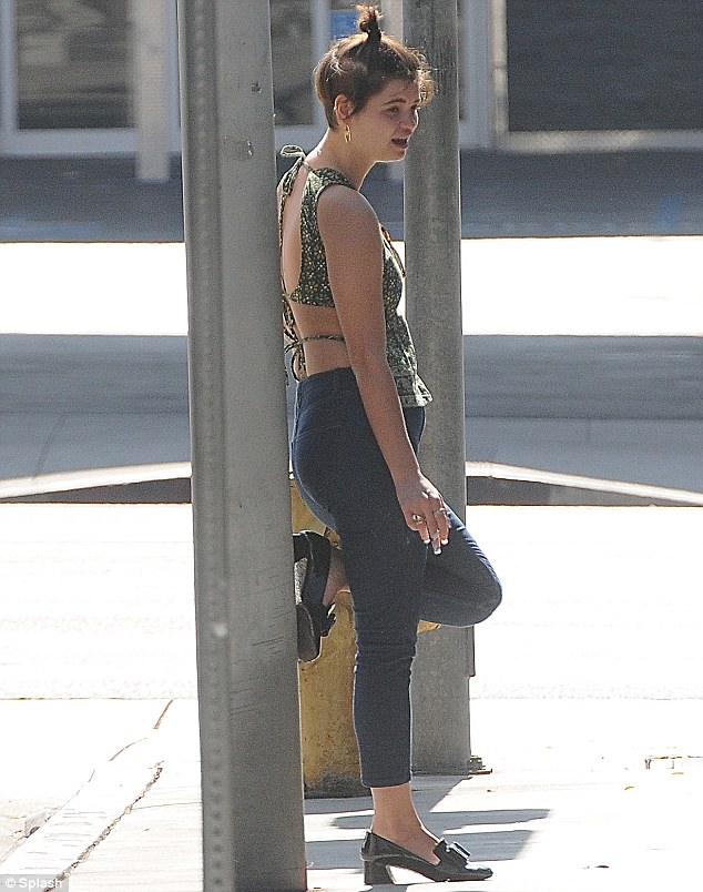 Sidewalk cool: Pixie Geldof was spotted enjoying a crafty cigarette solo in West Hollywood on Wednesday, while making the most of the sunshine