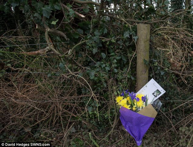 A bunch of flowers and a tribute lay at the scene today - where Scottish and Southern Electric engineers were working to make the area safe last night