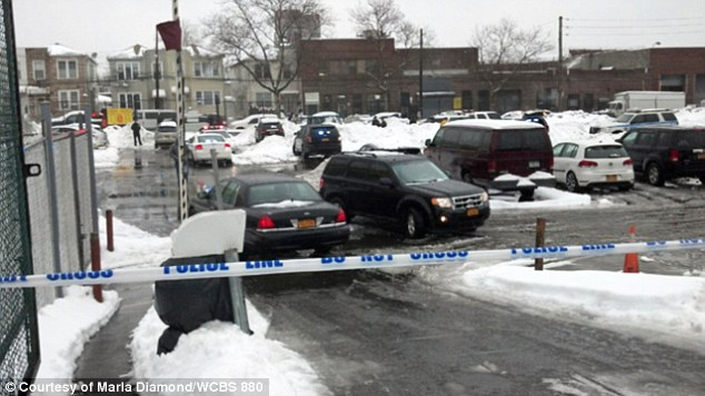 Investigation: Police tape cordons off the parking lot in Brooklyn after Min Lin, 36, was run over