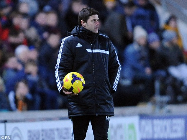 On the ball: Mauricio Pochettino is targeting FA Cup success for Saints to cap off his unbeaten run