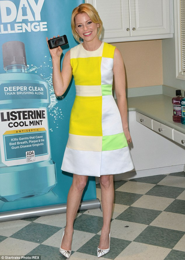 Say cheese! Elizabeth Banks lent her megawatt Crest ad smile to the launch of the Listerine 21 Day Challenge in Inglewood on Thursday