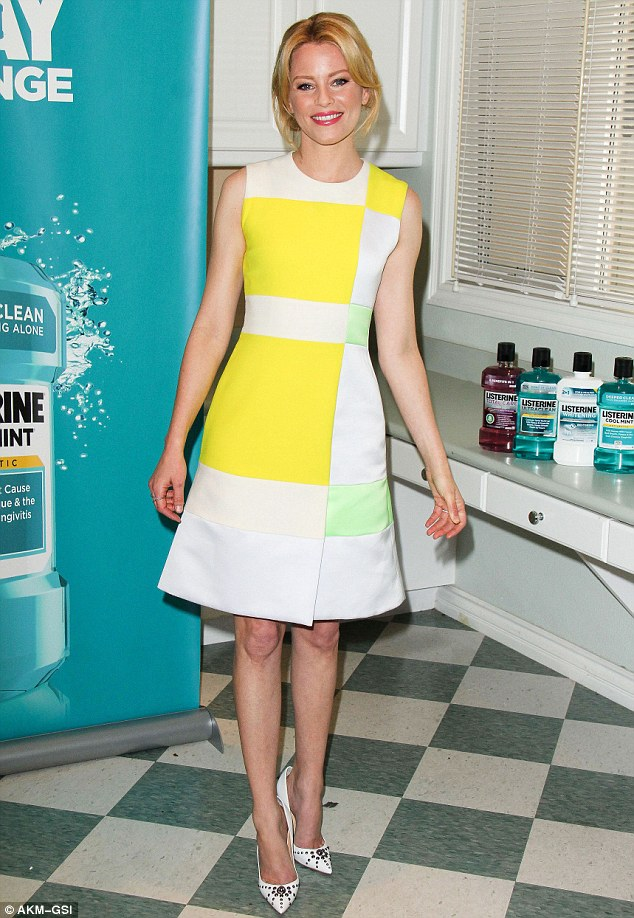 Little miss sunshine: The 40-year-old actress looked bright and perky in a crisp yellow, lime green, and white dress