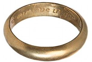 A gold posy ring with a D-sectioned hoop, floral decoration on the shoulders and a bezel set with opal from the 17th century