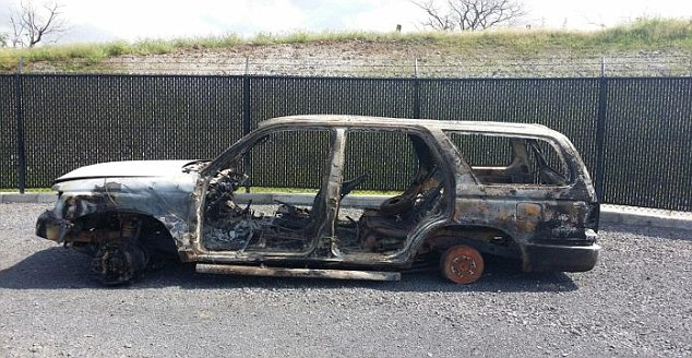 Abandoned: Miss Scott's car was found burnt out and on its side several days after her disappearance