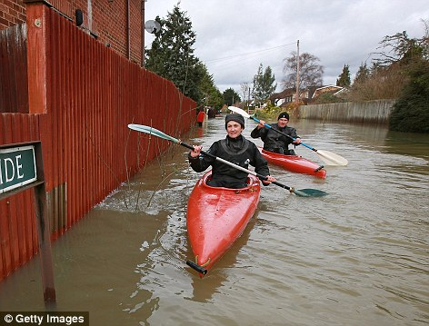 Transport: Canoes have been one of the only ways residents have been able to get around in areas ravaged by the floods