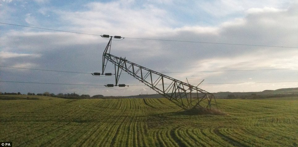 Destruction: A pylon near Houghton le Spring in Tyne and Wear was knocked over by high winds yesterday morning