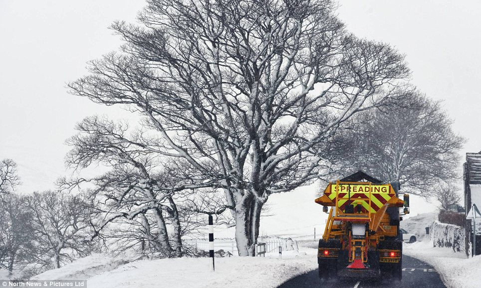 Action: A snow plough clears the roads in Northumberland after days of extreme weather