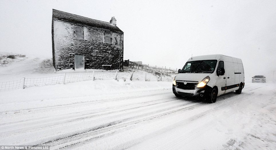 Caution: A van drives slowly along Hartside Pass in Cumbria as the north-west of England remains blanketed in snow