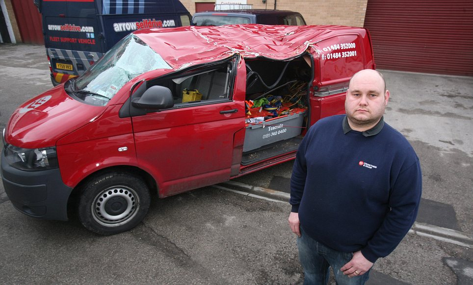 Close call: Andrew Turner survived when a tree fell onto his car because his metal toolbox took the brunt of the damage