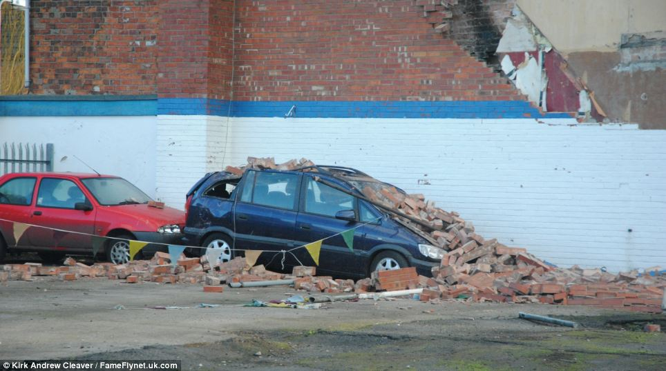 Storms and high winds ripped off roof tiles and a complete side of a building, destroying cars in Crewe