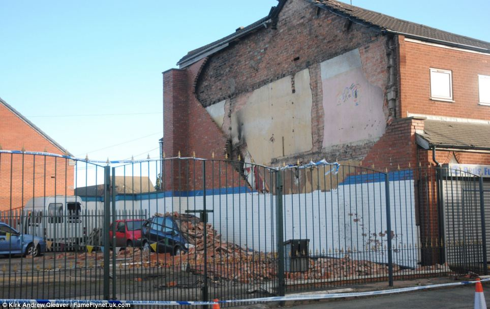 The debris fell onto several cars for sale in Oakridge Car Sales in West Street, Crewe. The road is still closed to traffic with the likelihood of the building to be demolished