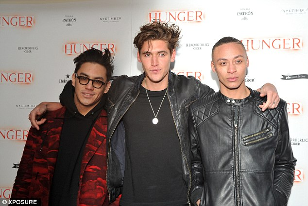 Cover star: Isaac Carew attends with fellow model Earl-James Atkinson and an equally fashionable friend