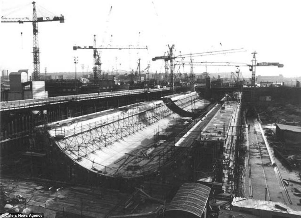 The movable barrier is made up of 10 gates attached to 39-metre tall cofferdam piles, which are buried 24 metres into the river bed. Pictured here is the barrier under construction