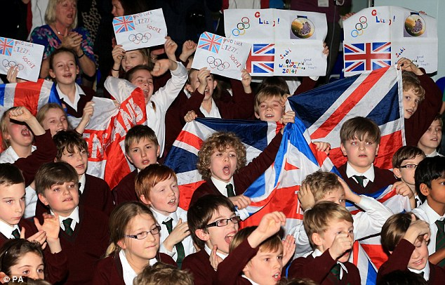 Support back home: Children from St Michael's School in Otford, Kent, support their former pupil