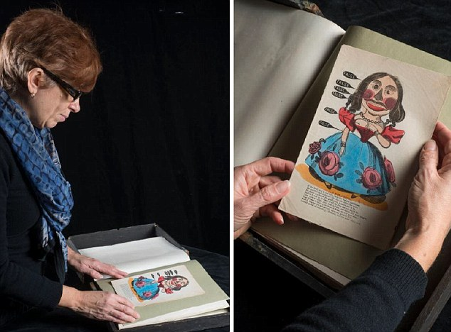 Museum of London Curator, Beverley Cook, inspects a comic Valentine's card printed as a woodcut on cheap paper with a caricature of a woman with various body parts labelled 'false'