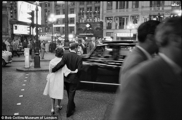 A couple weave across the road in the bustling West End. The photographer, Bob Collins, created a number of photographs at night playing with the bright lights of Piccadilly and Leicester Square