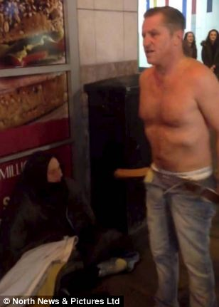 Edward strips down to his boxer shorts and gives the man his trousers