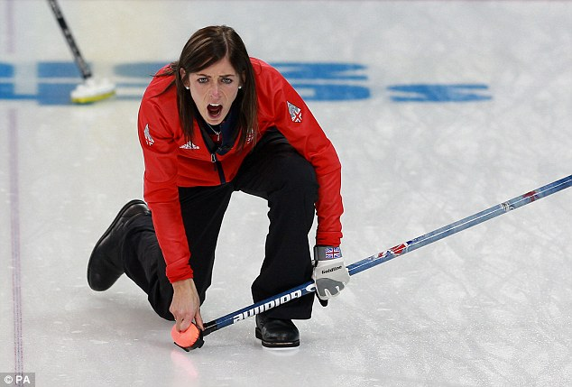 Focused: Eve Muirhead shouts at her team as she rolls an all-important stone during GB's curling win