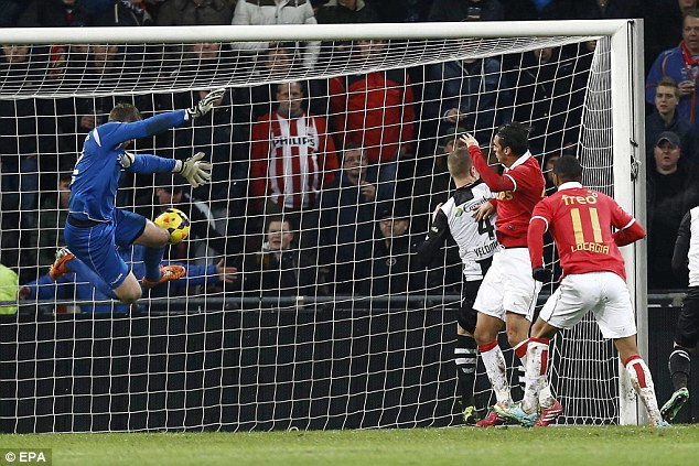 Matchwinner: Ruiz (second right) heads home the decisive goal in PSV's 2-1 win against Heracles