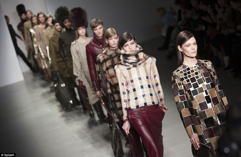Grande finale: The Daks show included all the classic British motifs including checks, trenches, leather and tailoring