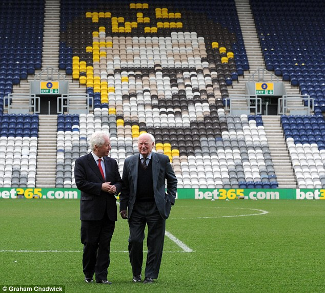 One club man: Finney (right), with Sportsmail's Jeff Powell, walk in front of his likeness at Deepdale