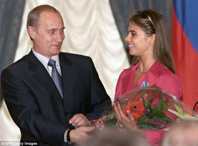 Rumours flooded the internet that Russian President Vladimir Putin has married glamorous Olympic gymnast Alina Kabayeva, right