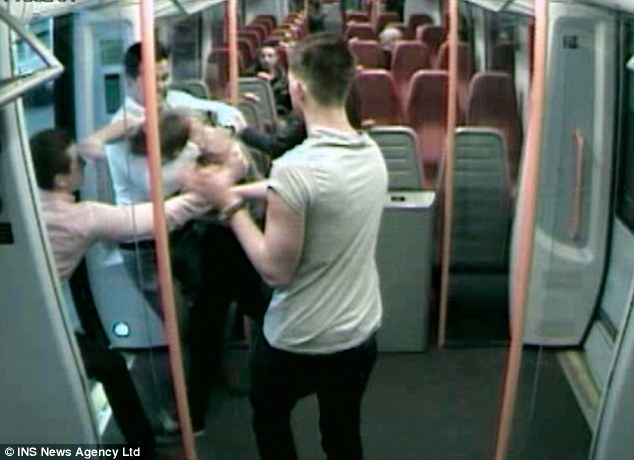 Altercation: Mr Harrison tries to intervene while terrified passengers watch the vicious fight unfold