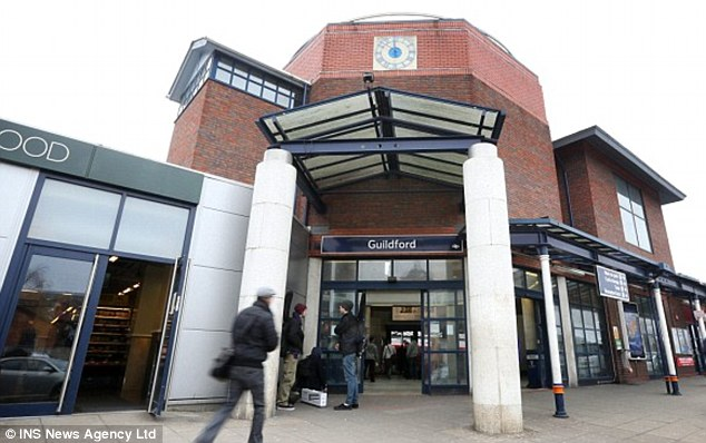 Scene: The brawl began after Mr Harrison made a joke about another passenger at Guildford station last March