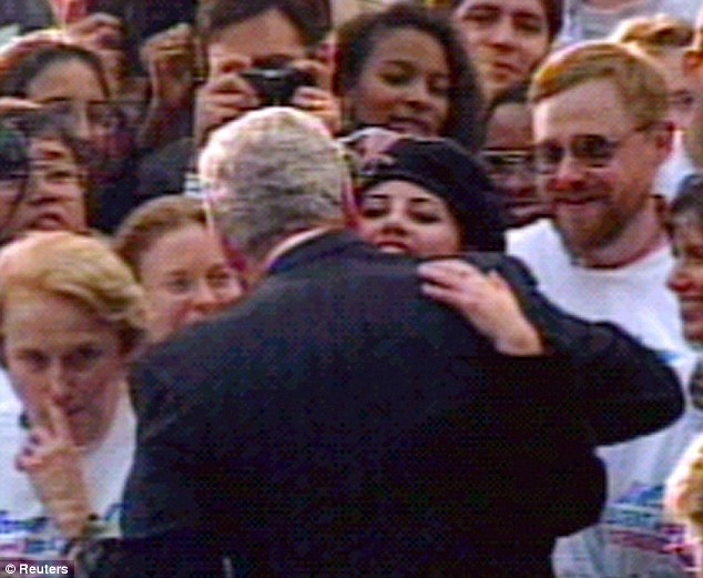 The famous shot: Bill Clinton embraces Monica Lewinsky in a crowd outside the White House on November 6, 1996