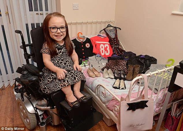 Chirpy: Georgia Rankin is like any other 15-year-old girl, apart from being 2ft 8in tall. Her friends in Warrington, Cheshire, call her Lil G and are helping her raise £18,000 for a specially-adapted wheelchair