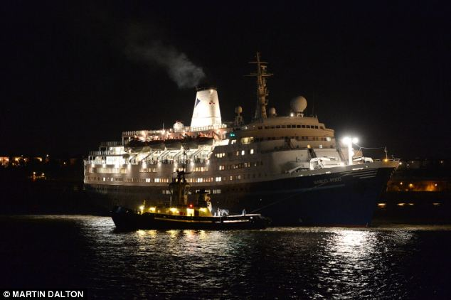 Return: The Marco Polo, pictured returning to Tilbury, Essex, last night after it's ill-fated Amazon cruise