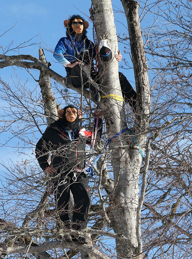 Monkey business: Ski coaches Scotty Veenis and Rewk Patton donned chimpanzee masks while perched in the trees at Rosa Khutor to watch the men's super-combined downhill on Friday