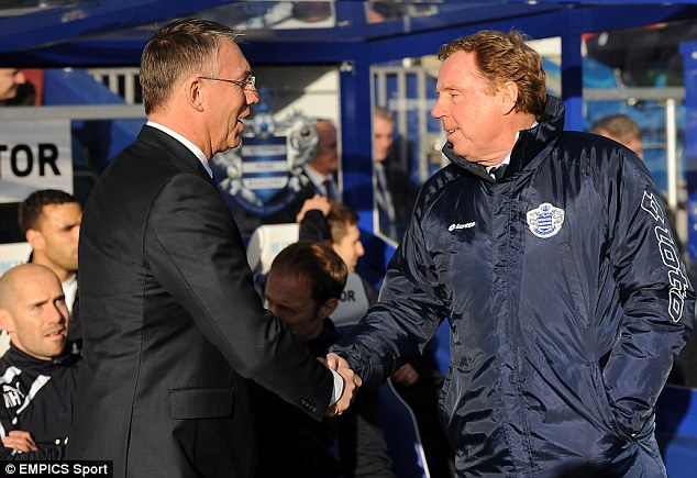 Great shakes: QPR manager Harry Redknapp welcomes his Reading counterpart Nigen Adkins