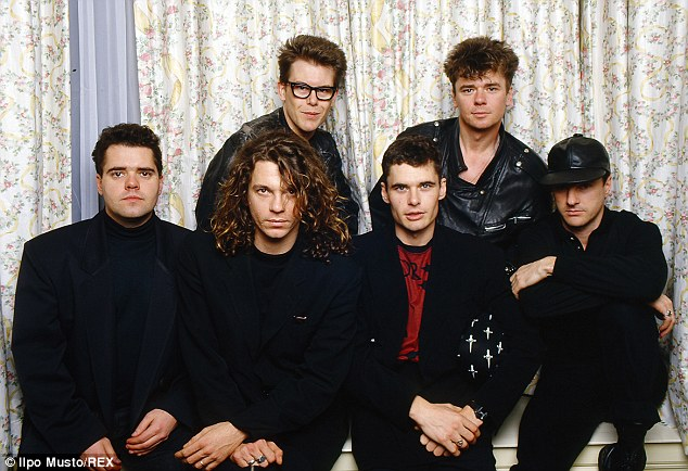 Lashing out: She also lashed out at Hutchence's INXS band members, seen here with Michael in a picture taken in a hotel room in Glasgow during the Nineties