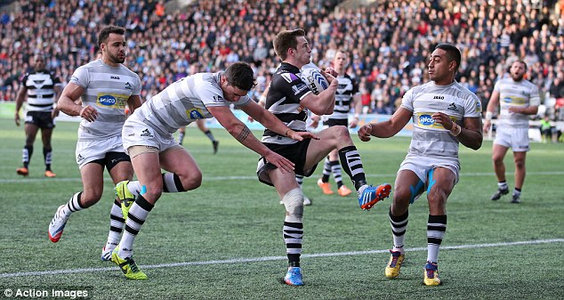 Winning: Joe Mellor (centre) scores a try for Widnes as his team romp to victory