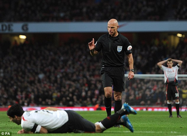No go: But Howard Webb controversially turned down the claims for a spot-kick