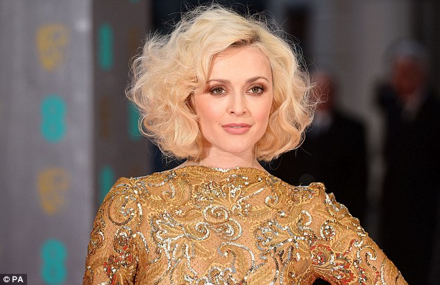 Voluminous: Fearne's hair was styled into a slightly-dated wavy 'do while she sensibly kept her accessories to a minimum