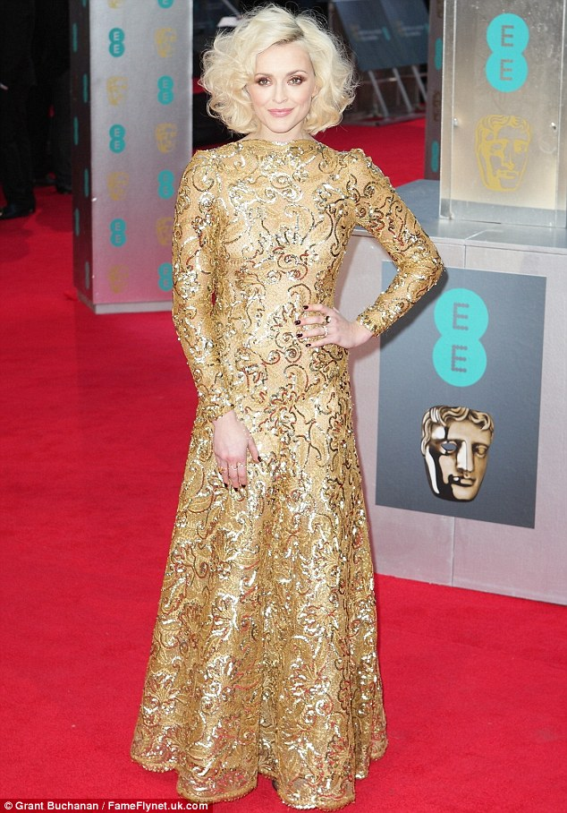 It's NOT the Golden Globes: Fearne Cotton wears head-to-toe gold as she arrives on the red carpet at the EE BAFTA Awards on Sunday evening