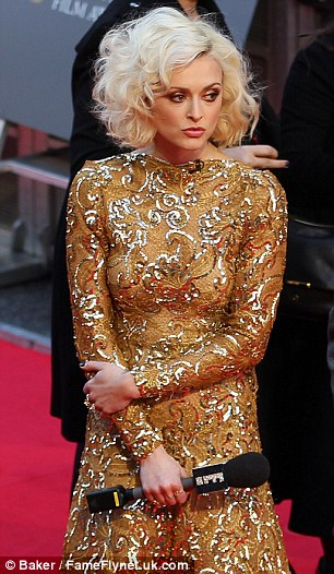 Cheer up: Fearne was spotted looking a little glum as she waited to chat to the arrivals