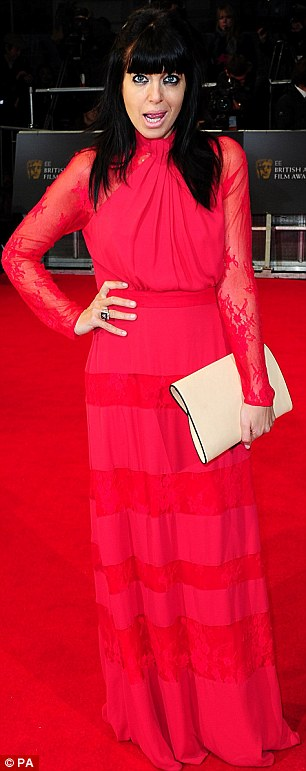 Matching the carpet: Fellow presenter Claudia Winkleman was seen arriving in a red lace tiered dress