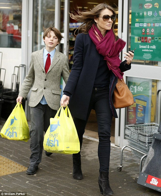 Just a normal mum: The day before the 48-year-old was spotted out food shopping with her son Damian after picking him up from school